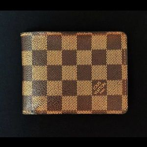 LV Authenic classic leather infold wallet